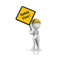 Plain figure with yellow hard hat holding yellow safety first sign.