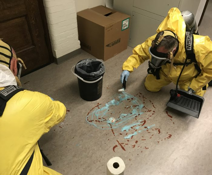 Environmental Health Employees Cleaning Up Spill